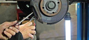 Man Repairing brakes on semi truck in Phoenix, Arizona